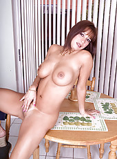 Busty Monica on the kitchen table