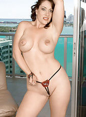 Hot MILF nude on high rise balcony