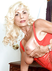 Blonde grannie reveals huge titties