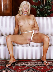 Blonde grannie plays with herself