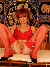 Redhead granny in lingerie gets some machine dildo