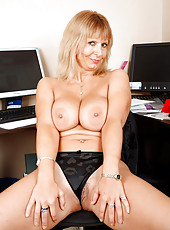 Hot cougar Alex flaunts her big tits and spreads her ass just to show her pink clit