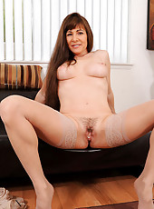 Enticing housewife Alexandra Silk likes to finger her hot mature pussy