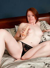 Lonely milf Ariana Carmine shoves a dildo deep into her mature pussy