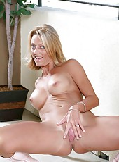 Long haired mature Anilos loves to expose her well mouth watering assets on the terrace