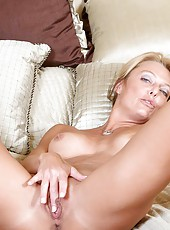 Hot alluring Anilos comforts herself by fingering her tight pink snatch in the bedroom