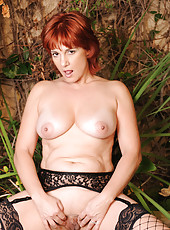 Anilos Calliste shows off her busty mature breasts and tender snatch
