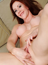 Alluring Anilos Catherine Desade spreads her mature pussy and stuffs her fingers inside