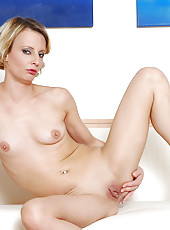 Charming blonde cougar woman spreads her pink and flaunts her small tits