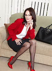 Business woman Danielle Reage loves to stuff her mature pussy with a glass dildo