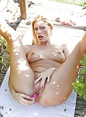 Leggy blonde cougar penetrates her mature wet pussy with a vibrator in the garden