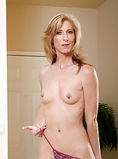 Charming Anilos Dee Dee inserts a huge dildo in her tight pink milf pussy