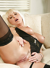 Attractive blonde Anilos spreads her juicy milf pussy revealing her tantalizing pink clitoris