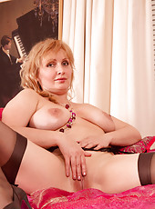 Hot Momma Emma pinches her own tits and spreads her pink pussy on her bed