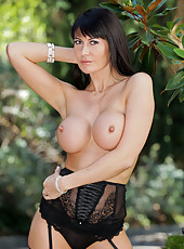 Eva Karera slips off her lace lingerie outdoors unleashing her elegant milf beauty