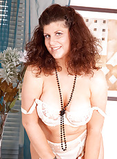 Gorgeous Anilos Gilly flaunts her sultry nude mature body in her bedroom