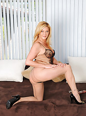 Horny blonde milf brings herself to ecstacy as she slams her glass dildo deep inside of her slippery fuck box