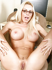 Lovely blonde secretary exposes her enticing mature body in the office