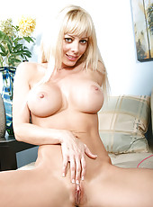 Foxy Anilos Holly flaunts her luscious nude milf body on the couch