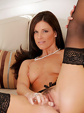 Horny Anilos cougar in black stockings thrusts a glass dildo in her milf pussy