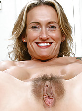 Sizzling Anilos Jolie peels off her evening wear and exposes her breast and pussy