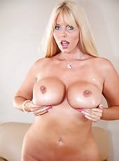 Curvy blonde cougar teases her milf pussy with her magic wand