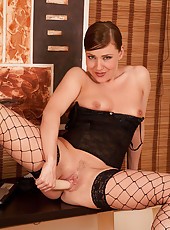 Naughty cougar Karen Wood slides off her thongs and fucks herself on the couch