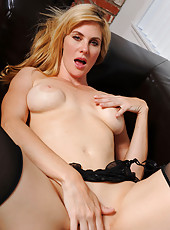 Anilos Kate Kastle caresses her pink pussy on the couch and flaunts her hot ass