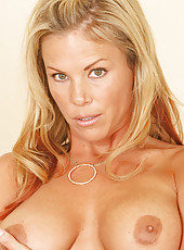 Experienced milf kayla synz pinches her large brownish erect nipples