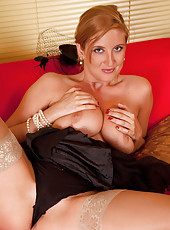 Nymph cougar fucks her sweet pink pussy on the couch and flaunts her tight round ass