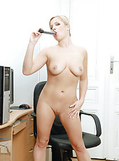Horny business woman takes a break from work and thrusts a silver vibrator in her snatch