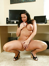 Busty anilos cougar maya divine flaunts her body in all of its naked glory in her home office