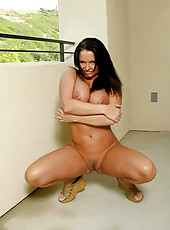Experienced milf shows off her enormous tits and her well groomed fuck box