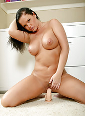 Maya divine takes a break from her chores to ride the suction cup dildo
