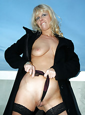 Anilos milf merilyn is quite the exhibitionist as she flashes her well groomed snatch outdoors