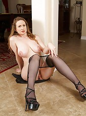 Glamorous Anilos cougar pulls off her sheer black pantyhose exposing her sweet pussy