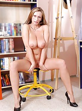 Naturally sexy mature woman spreads her silky legs open to reveal her juicy pink