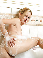Mesmerizing blonde anilos soaks in the bubble bath and explores her mature pussy with her fingers