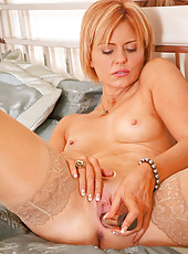 Anilos hottie slides off her thong and spreads out her pussy exposing her swollen pink clit
