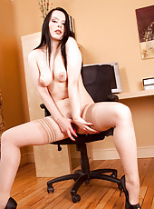 Long haired Rebekka Raynor gets naked in the office and masturbates her mature pussy with a pointed dildo