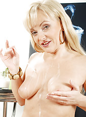 Foxy blonde cougar drizzles milk all over her mature tits and pussy