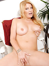 Hot mature blonde strips off her clothes and gently slips a dildo in her pussy