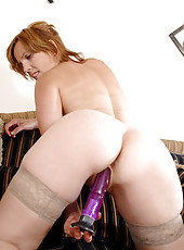 Sadie has fun sticking the rabbit in her tight cougar pussy