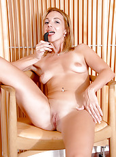 Totally nude milf satisfies her sex cravings with a dildo while hubby is away