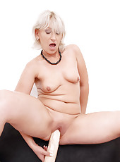 Totally nude milf Samantha White masturbates with a giant dildo when her hubby is away