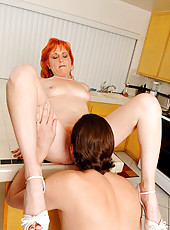 Horny redhead Sasha Brand gets an intense hardcore fucking from a stud in the kitchen