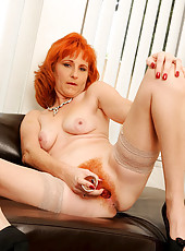 Nude Anilos cougar Sasha Brand eases her sex cravings with her glass sex toy