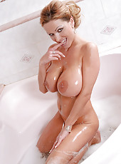 Lovely Sharon Pink pours liquid bath soap on her huge tits and masturbates in the bathtub