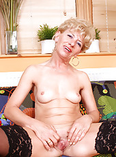 Seductive blonde milf bares her fair skinned mature body and fondles her juicy snatch for a solo orgasm