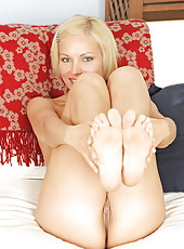 Petite blonde cougar spreads her sugary pussy flirtatiously